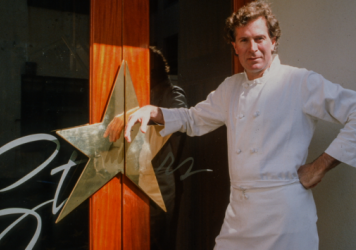 The irascible chef poses in front of his San Francisco restaurant in the documentary <em>Jeremiah Tower: The Last Magnificent.</em>