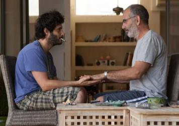 Zooler (Tomer Kapon) bonds with his grieving neighbor Eyal (Shai Avivi) in <em>One Week and a Day</em>.