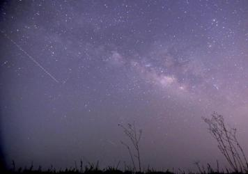 Conditions are expected to be ideal for viewing the Lyrid meteor shower on Friday night and Saturday morning.This long-exposure photograph taken on April 23, 2015, shows the Lyrid meteors passing near the Milky Way in the clear night sky near Yangon, Myanmar.