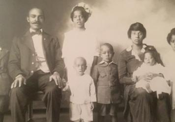 "Left to right: George Fermon (standing), Benjamin F. Fermon (seated, author's grandfather; father of children pictured), Jessie Fermon (standing, back row), Benjamin ""Bizzy"" Fermon (front row, white romper), Harold Fermon, (grey knee-britches suit), Jessie Amy Anderson Fermon (seated, author's grandmother; mother of children), Frances Fermon, (on Jessie Amy's lap) Gladys Fermon (standing)"