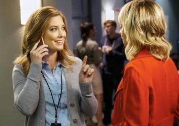 Briga Heelan plays Katie, a news producer whose mother barges in on her already chaotic workplace.