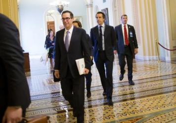Treasury Secretary Steve Mnuchin (center) arrives Tuesday at a meeting with congressional leaders to discuss a tax overhaul.