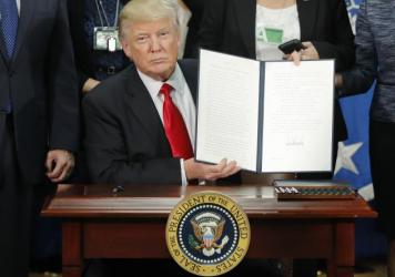 President Trump signs an executive order on immigration enforcement and sanctuary cities on Jan. 25.