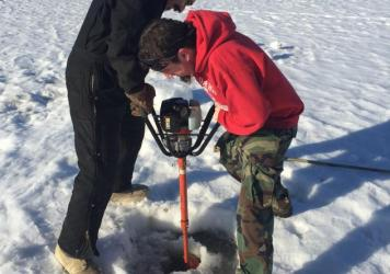 Judah (left) and Josh Ridgeway drill a hole in the Tanana River at Nenana, Alaska to measure the thickness of the ice on April 13th.