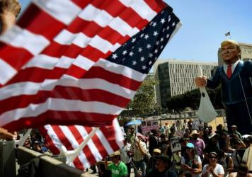"""Members of the """"Full Rights for Immigrants Coalition"""" displayed a giant effigy of then-candidate Donald Trump on May Day in Los Angeles last year."""