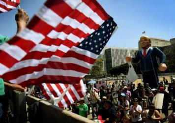 "Members of the ""Full Rights for Immigrants Coalition"" displayed a giant effigy of then-candidate Donald Trump during a protest on May Day in Los Angeles in 2016. (Mark Ralston/AFP/Getty Images)"
