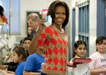 Former first lady Michelle Obama waves alongside school children while walking down the school lunchline after getting turkey tacos at Parklawn Elementary School in Alexandria, Va., in January 2012 to promote new nutritional guidelines for school lunches