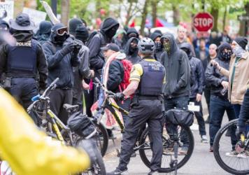 "In Portland, Ore., a May 1 rally and march began as a peaceful demonstration but later ""devolved into a full-scale riot,"" police say."