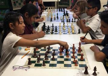 Killip Elementary third graders Alexa Cardenas (left) and Luis Gonzalez (right) are preparing for the chess SuperNationals.
