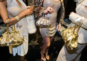 Jackie and friends with Versace handbags at a private opening at the Versace store, Beverly Hills, California, 2007.