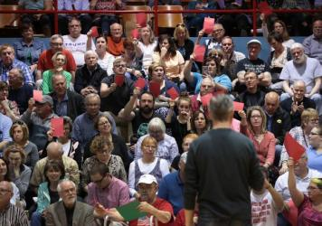 People attending Rep. Rod Blum's town hall event in Dubuque, Iowa, this week held up red sheets of paper to show disagreement with what the Republican congressman was saying and green to show they concurred. The GOP health care bill was a major concern o
