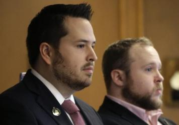 New Hampshire State Rep. Robert Fisher, left, at a public hearing earlier this week. Fisher says reports of alleged comments he made online degrading women were taken out of context.