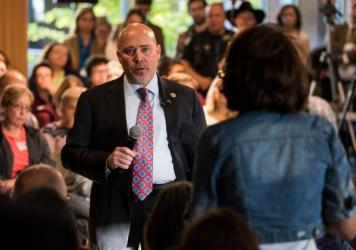 Rep. Tom MacArthur, R-N.J., faces angry constituents at a town hall meeting Wednesday in Willingboro, N.J. MacArthur wrote a key amendment to the American Health Care Act.