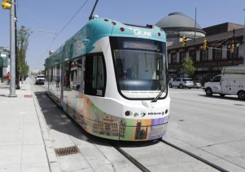 A streetcar rides along Woodward Avenue on Friday in Detroit — the city's first in 61 years. The QLine project was led by private businesses and philanthropic organizations in partnership with local, state and the federal government.