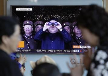 """North Korean leader Kim Jong Un is shown on TV at the Seoul Railway Station in South Korea on Sunday, when North Korea test-launched a """"medium long-range"""" missile that landed in the Sea of Japan — a direct challenge to the new South Korean president."""