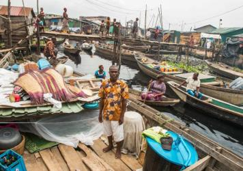 Former residents from the waterfront settlement of Otodo Gbame in Lagos. They've been displaced and are now living in Makoko, another waterfront slum.<em> </em>