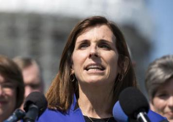 "Rep. Martha McSally speaks last year on Capitol Hill. An Arizona man was arrested last week and accused of threatening the congresswoman, saying among other things, that he ""can't wait"" to pull the trigger on her."