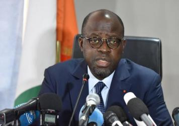 Ivorian Defense Minister Alain-Richard Donwahi addresses a news conference Tuesday in Abidjan after reaching an agreement with disgruntled soldiers, who led a days-long mutiny protesting delays in bonus payments.