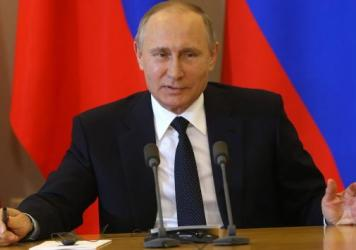 """Russian President Vladimir Putin says """"political schizophrenia"""" has gripped the U.S., as he discussed reports that President Trump had shared secrets with Russia's top diplomats."""