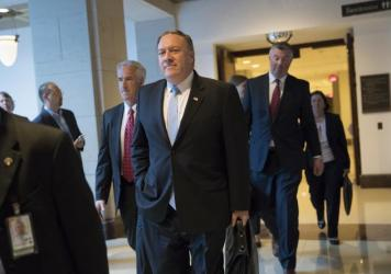 CIA Director Mike Pompeo departs the Capitol on Tuesday after briefing members of the House Intelligence Committee following reports that President Trump shared classified information with two Russian diplomats during a meeting in the Oval Office.