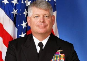U.S. Navy Rear Admiral Robert Gilbeau has been sentenced to 18 months in prison for lying to federal officials investigating a massive corruption scandal.