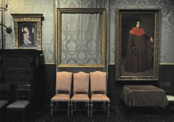 The empty frame (center) from which thieves cut Rembrandt's <em>Christ in the Storm on the Sea of Galilee</em> remains on display at the Isabella Stewart Gardner Museum in Boston in 2010. The painting was one of more than a dozen works stolen from the museum in 1990.