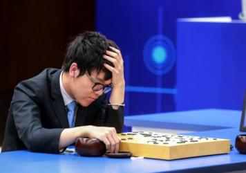 Ke Jie, the world's No. 1 Go player, stares at the board during his second match against AlphaGo in Wuzhen, China, on Thursday. The 19-year-old grandmaster dropped the match in the best-of-three series against Google's artificial intelligence program.