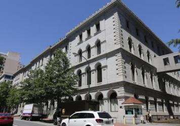 The 4th U.S. Circuit Court of Appeals building in Richmond, Va., was the site of a court hearing on President Trump's revised travel ban targeting six Muslim-majority countries earlier this month. A 13-judge panel has ruled that the ban should continue t