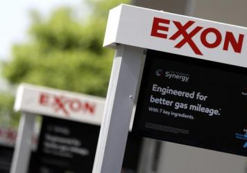 "The Exxon Mobil shareholder vote is seen as a victory for environmental activists and one that is aimed at getting the company to consider ""material risk,"" according to <em>The Dallas Morning News</em>."