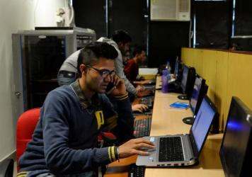 An employee of Indian IT security solutions company Innefu Labs works at its offices in New Delhi. Newer fields, including artificial intelligence, will require highly advanced skills, analysts say.