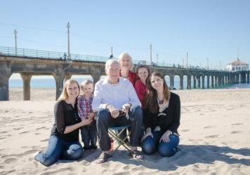 John Minor (center) in December 2014, surrounded by his family — Jackie Minor (left), Soren Johnson, John Minor, Sherry Minor, Skyelyn Johnson and Valerie Minor Johnson — in Manhattan Beach, Calif.