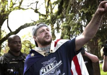 "Jeremy Christian, right, seen during a Patriot Prayer, allegedly stabbed three men, two fatally, in Portland last month. During a subsequent courtroom appearance, he exclaimed: ""Free speech or die, Portland. You call it terrorism I call it patriotism."""