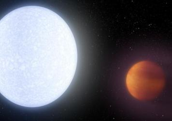 An artist's conception of the KELT-9 system, which has a host star (left) that's almost twice as hot as our sun. The hot star blasts its nearby planet KELT-9b, leading to a dayside surface temperature of around 7,800 degrees Fahrenheit.