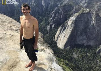 Alex Honnold smiles after scaling El Capitan in Yosemite National Park, in a photo provided by <em>National Geographic</em>. Honnold became the first person to climb alone to the top of the massive granite wall without ropes or safety gear.