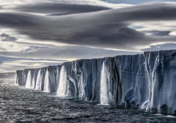 The Nordaustlandet ice cap gushes high volumes of melt water. Even though this photograph was taken just 600 miles from the North Pole, the temperature was in the high 60s Fahrenheit.