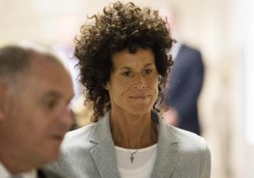 Andrea Constand walks to the courtroom during Bill Cosby's sexual assault trial in Norristown, Pa., on Tuesday. Cosby is accused of drugging and sexually assaulting Constand at his home outside Philadelphia in 2004.
