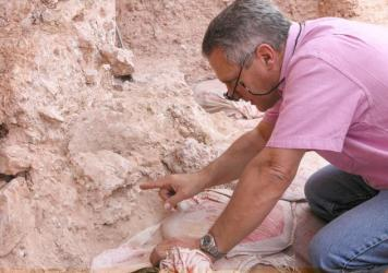 Paleoanthropologists carefully excavate the remains of five ancient individuals, discovered in what was once a large cave. The cave at what's now known as the Jebel Irhoud site in Morocco became buried, over the eons, under layers of rock and sediment.