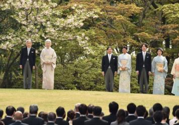 Japan's parliament has approved a law permitting Emperor Akihito (left) to abdicate the throne as he requested. Members of the deliberately small royal family, including Empress Michiko (second from left), attend a spring garden party at the Akasaka Palace in Tokyo.