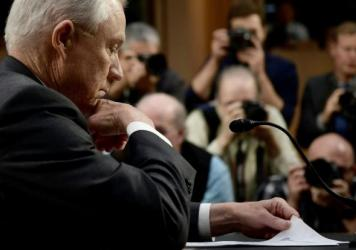 Attorney General Jeff Sessions looks through papers prior to testifying before the Senate Intelligence Committee on Tuesday.
