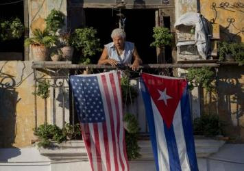 Javier Yanez decorated with U.S. and Cuban flags in Old Havana, Cuba, in 2014. President Trump is expected to reverse some of the easing in U.S.-Cuba relations that President Obama initiated.
