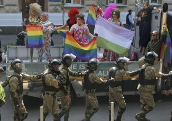A heavy police presence guarded supporters of LGBT rights at the Gay Pride parade in Kiev Sunday. In previous years, violence has broken out between Pride supporters and far-right protesters.