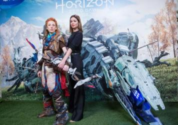 "Cosplayer dressed as Aloy (left) and Spanish actress Dafne Fernandez present the ""Horizon: Zero Dawn"" video game on Feb. 15 in Madrid, Spain."