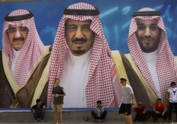 A billboard in Taif, Saudi Arabia, shows King Salman bin Abdul-Aziz Al Saud (center) flanked by his 31-year-old son, Mohammed bin Salman (right), and Prince Mohammed bin Nayef. The king appointed his son as his successor and first in line to the throne, stripping Nayef of the title of crown prince and ousting him from his powerful position of interior minister.