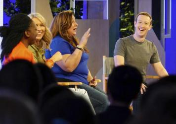 Facebook CEO Mark Zuckerberg, right, speaks with panelists at the Facebook Communities Summit on Thursday, where he announced Facebook's mission will change to focus on the activity level of its users. From left are Lola Omolola, Erin Schatteman and Janet Sanchez, who run popular Facebook groups.