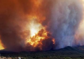 Flames and smoke rise from a fire near Mayer, Ariz. By Thursday, the Goodwin Fire had burned more than 20,000 acres and was just 1 percent contained.