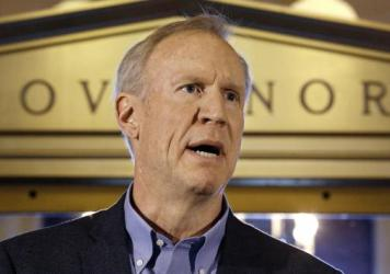 Illinois Gov. Bruce Rauner speaks to reporters in front of his office at the State Capitol in Springfield, on June 30, 2016. Illinois lawmakers had just passed a stop-gap budget. More than a year later, legislators have finally reached a budget deal, whi