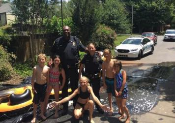 """A police officer """"blown away"""" by the size of a neighborhood party's slip-and-slide, persuades her partner to follow her down."""