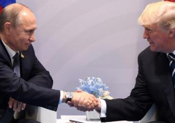 President Trump and Russia's President Vladimir Putin shake hands during a meeting on the sidelines of the G-20 Summit in Hamburg, Germany, on Friday.