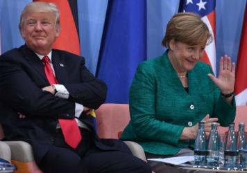 Despite President Trump's decision to withdraw from an international climate accord, other leaders affirmed their commitment to the plan at the G20 Summit. Trump is seen here with German Chancellor Angela Merkel on Saturday.