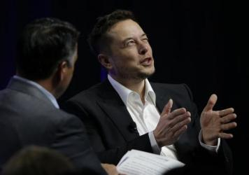 """Tesla and SpaceX CEO Elon Musk responds to a question by Nevada Republican Gov. Brian Sandoval during the third day of the National Governors Association's meeting on Saturday in Providence, R.I. Among other things, Musk warned governors that artificial intelligence poses a """"fundamental risk to the existence of human civilization."""""""